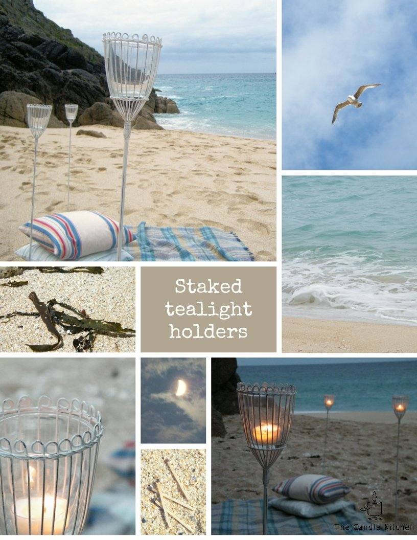 Staked tealight holders on a beach