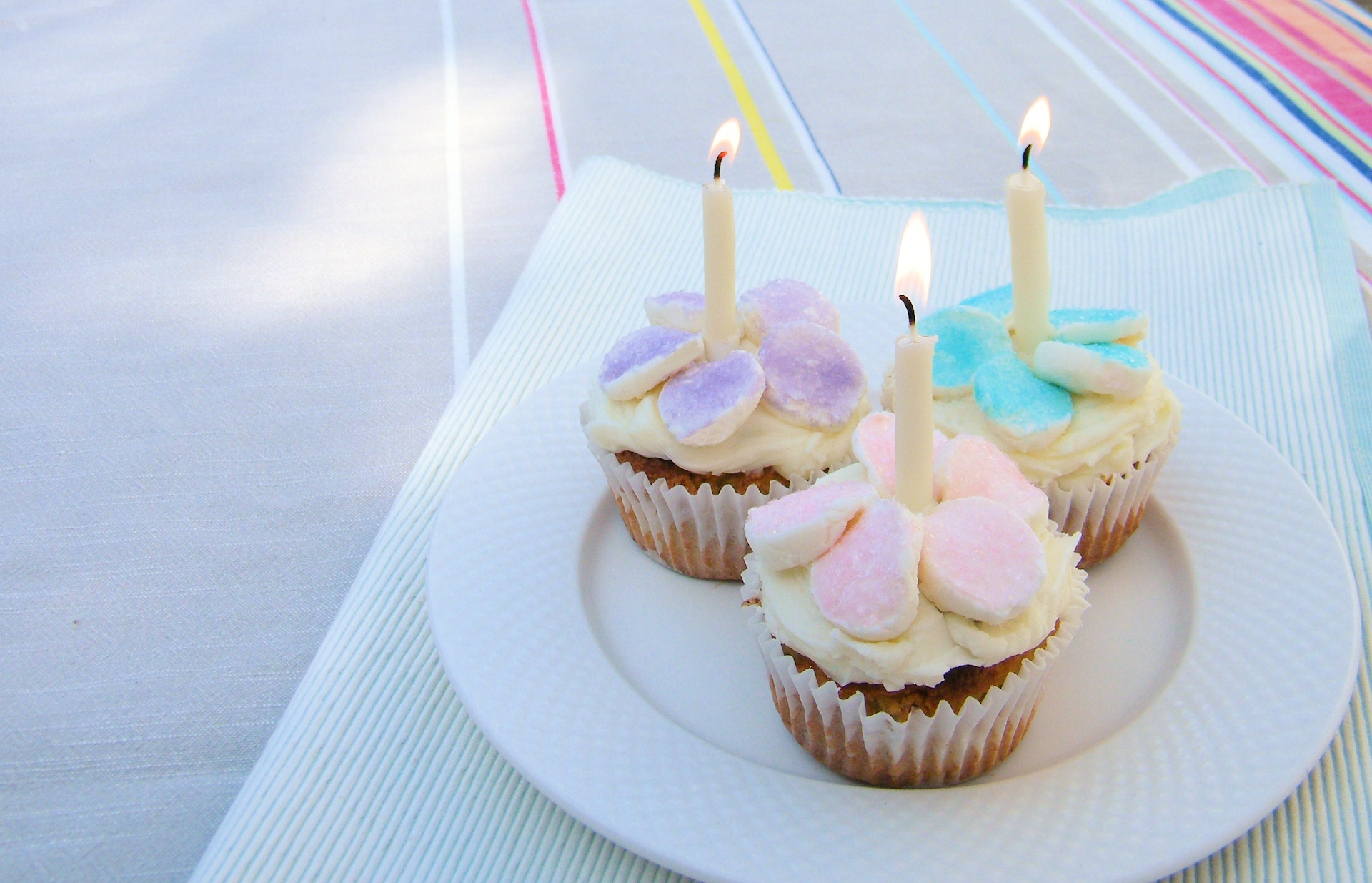 Fairy cakes with white beeswax candles